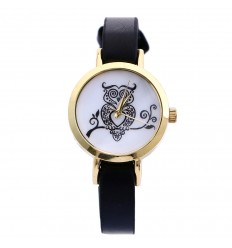 """Shows woman, strap end, small dial pattern """"owl""""."""