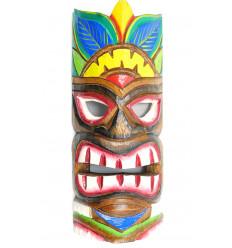 Masque tiki en bois multicolore. Décoration ambiance Hawaï maori.