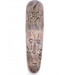 Maschera africana in legno sbiancato tartaruga, per decorare una parete di colore.