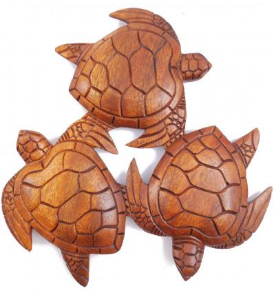 Décor mural ronde des tortues en bois, fabriqué artisanalement à Bali.