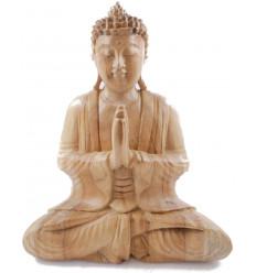 Statue de Bouddha assis mains jointes en bois brut h30cm