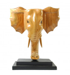 Large elephant head wooden wall, in the style of a hunting trophy.