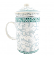 Mug to brew tea in porcelain floral pattern blue. 3-in-1 practice.